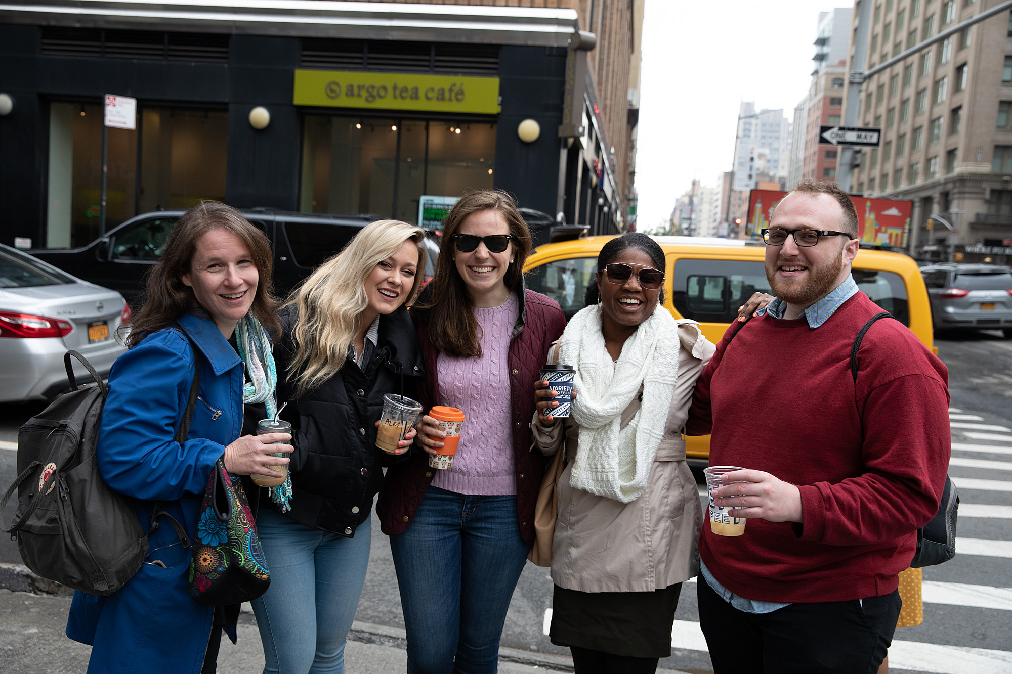 Michelle Kedem, Kristen Poemer, Alana Althans, Imani Doyle, and Sivan Philo pose for a photo on a busy New York City street after a coffee break